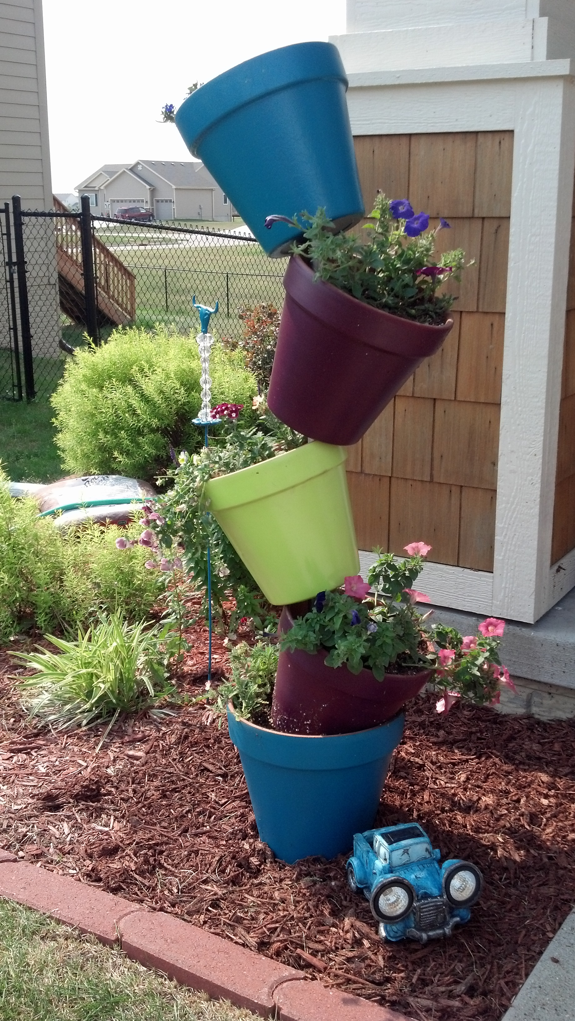 Her Pinspiration Leaning Tower of Flowers – Her View From Home