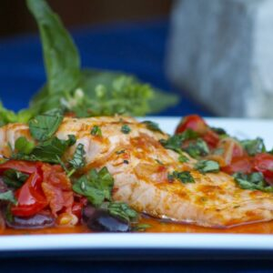 Grilled Salmon with Tomato Pepper Relish and Black Olives
