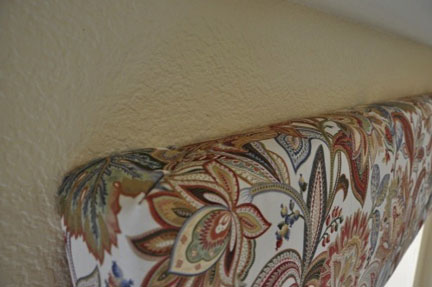 detail shot of fabric attached to corner of box valance frame