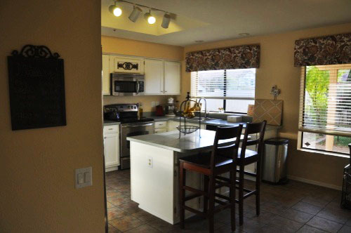 wide shot of kitchen showing two DIY box valances installed on windows