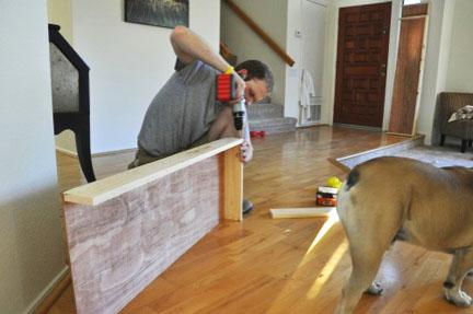 homeowner screws together frame for box valance