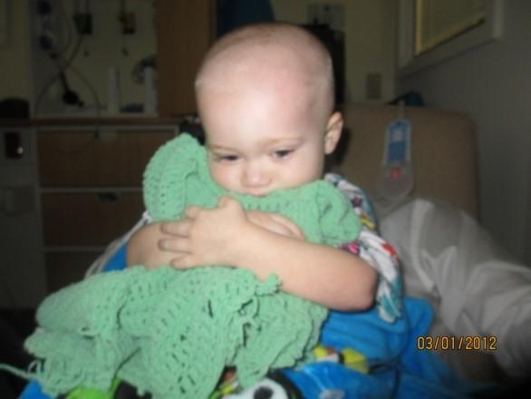 Cooper with his favorite blanket, Greenie