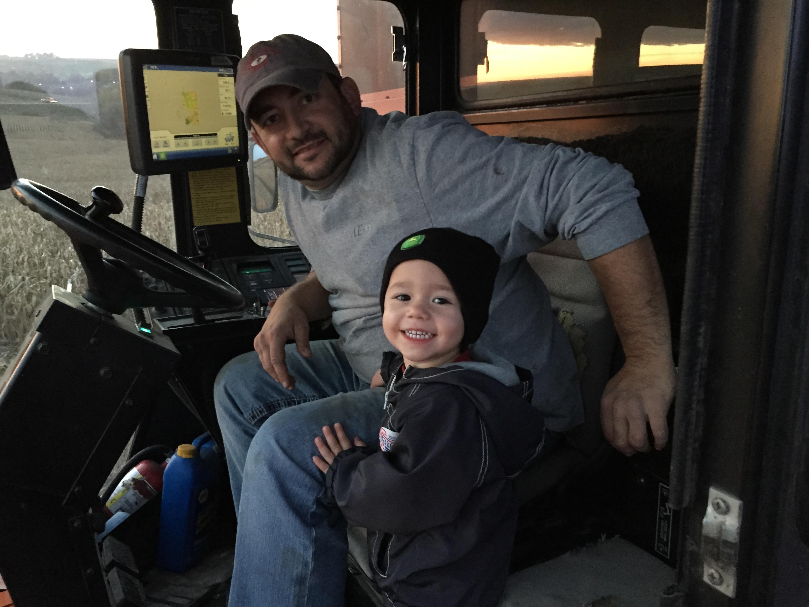 Farmkid harvesting with daddy