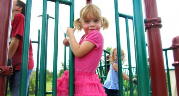 Little girl on playground, color photo