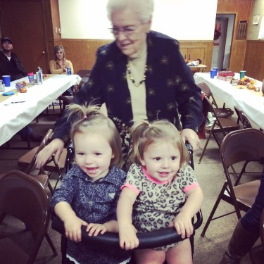 "Great Grandma ""carrying"" the little girls."
