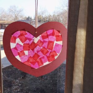 "Your Kids Will Love This Very Simple Valentine's Day Stained ""Glass"" Craft"
