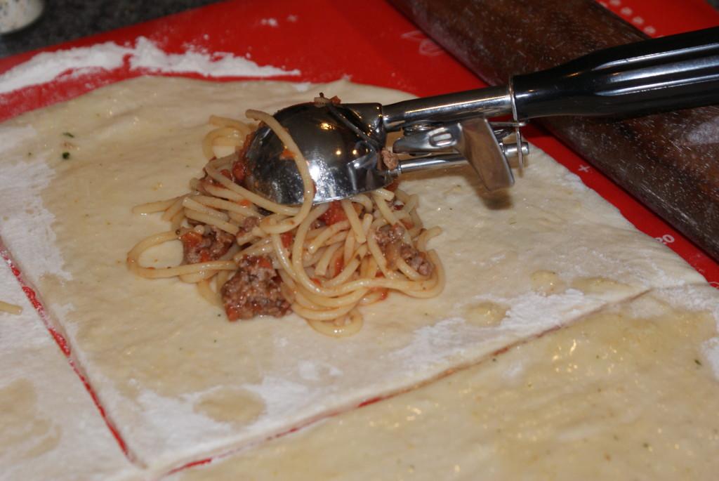 Spaghetti-Stuffed Calzone   www.herviewfromhome.com