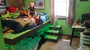 "The fact that daddy built both of the boys these custom ""fort beds"" last year is truly coming in handy now."