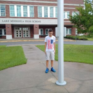 The Boy Who Stood at The Flag Pole Alone