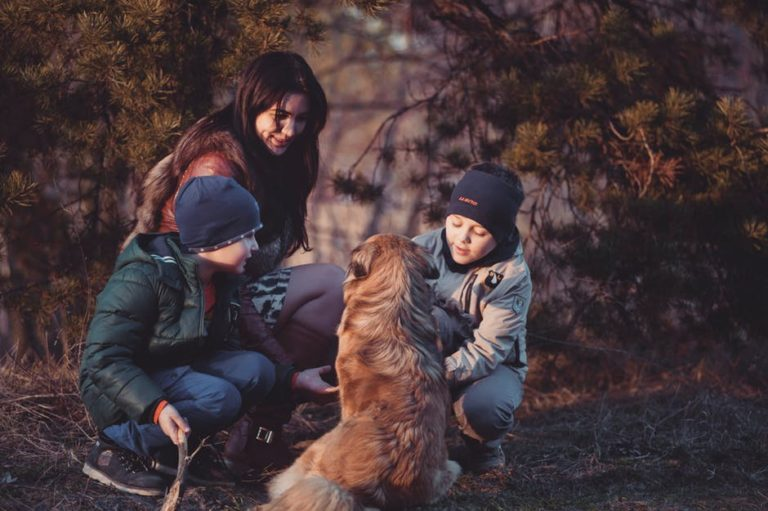 Stepmom with her two children and dog