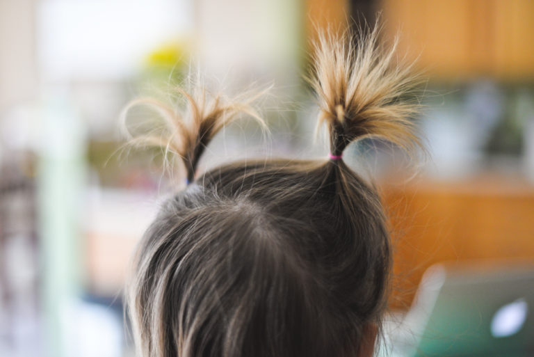 Little girl's head with pigtails, color photo