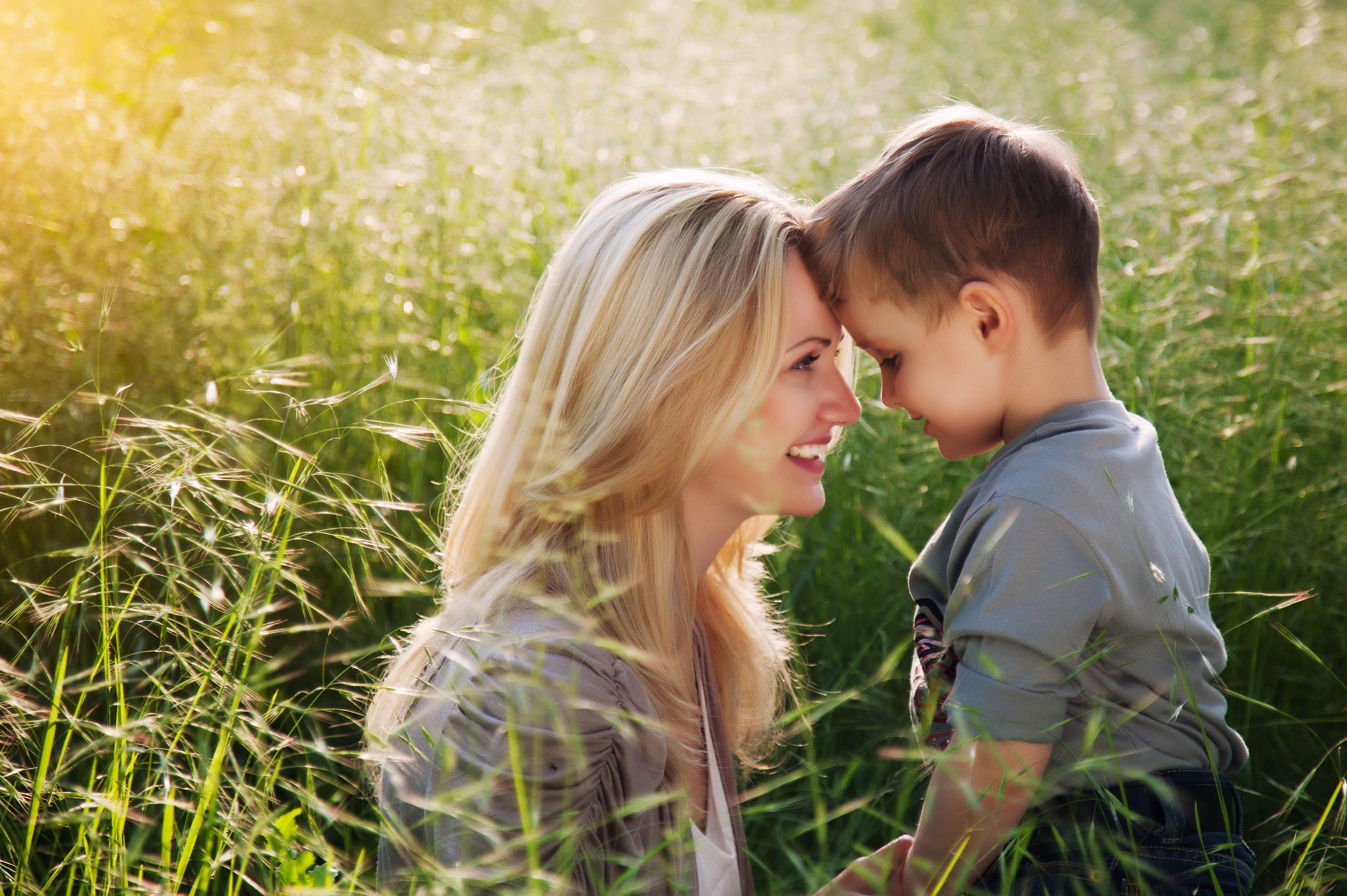 Mother with son in field