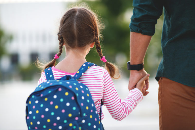 Child holding hand of father
