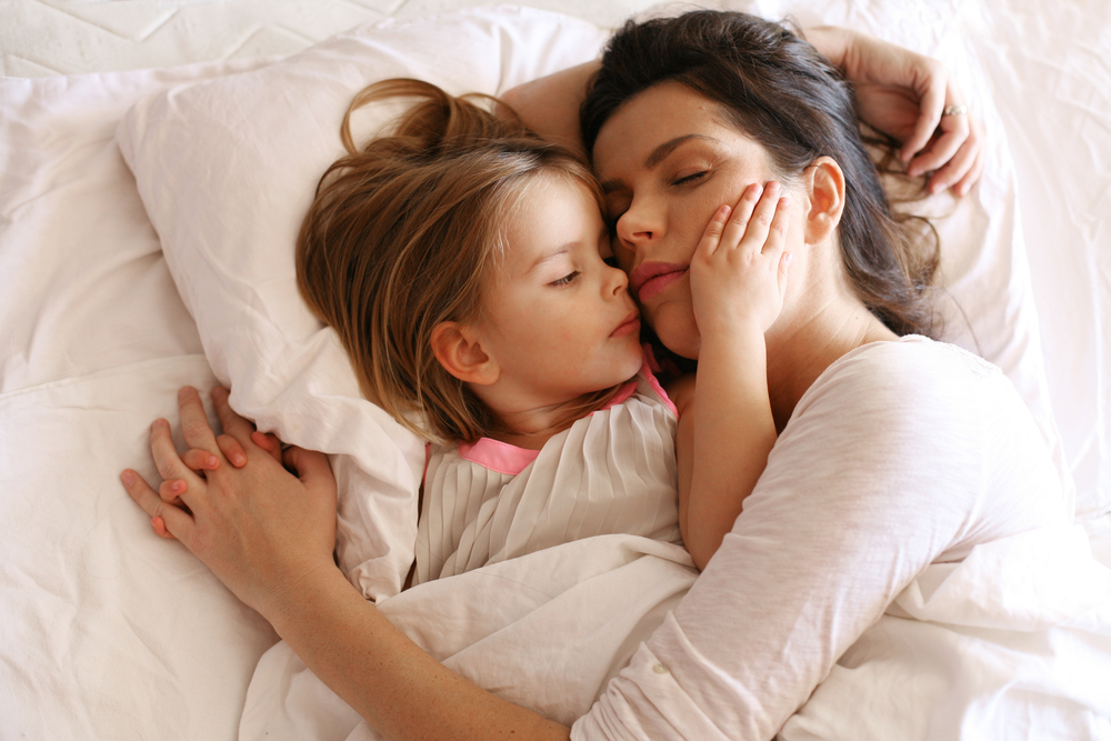 Mom and daughter sleeping