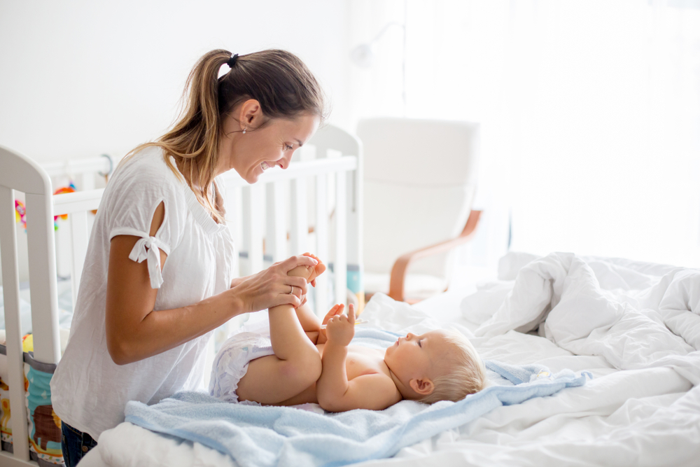 young mother changing baby www.herviewfromhome.com