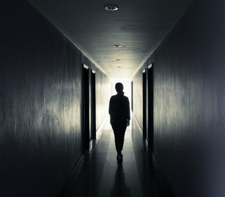 woman walks down hallway www.herviewfromhome.com