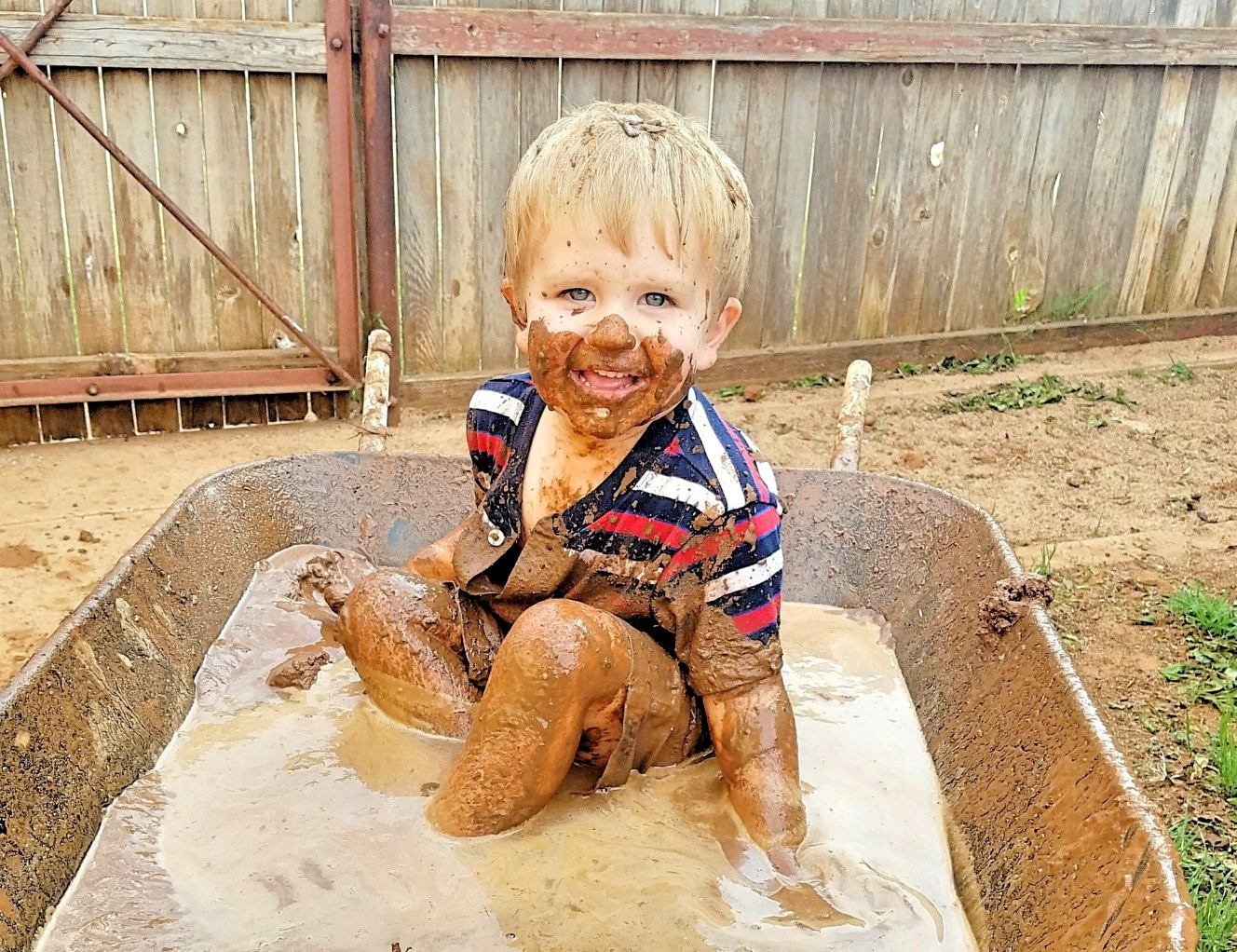 little boy playing in the mud www.herviewfromhome.com