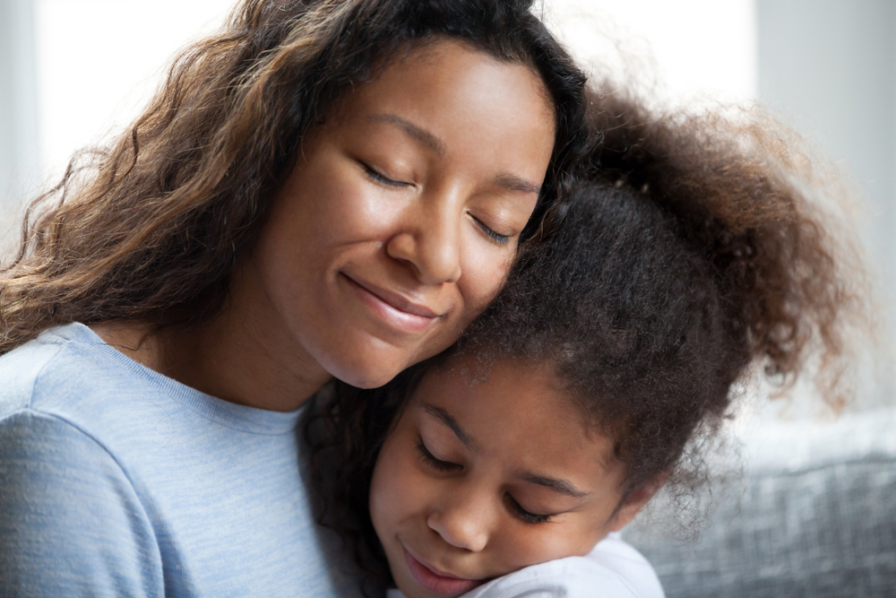 mother embracing daughter www.herviewfromhome.com