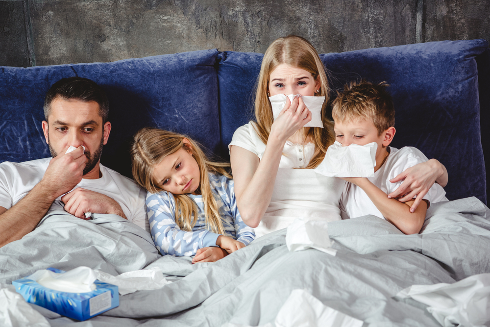 sick family in bed www.herviewfromhome.com