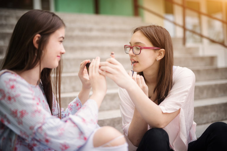 teen girls applying makeup www.herviewfromhome.com
