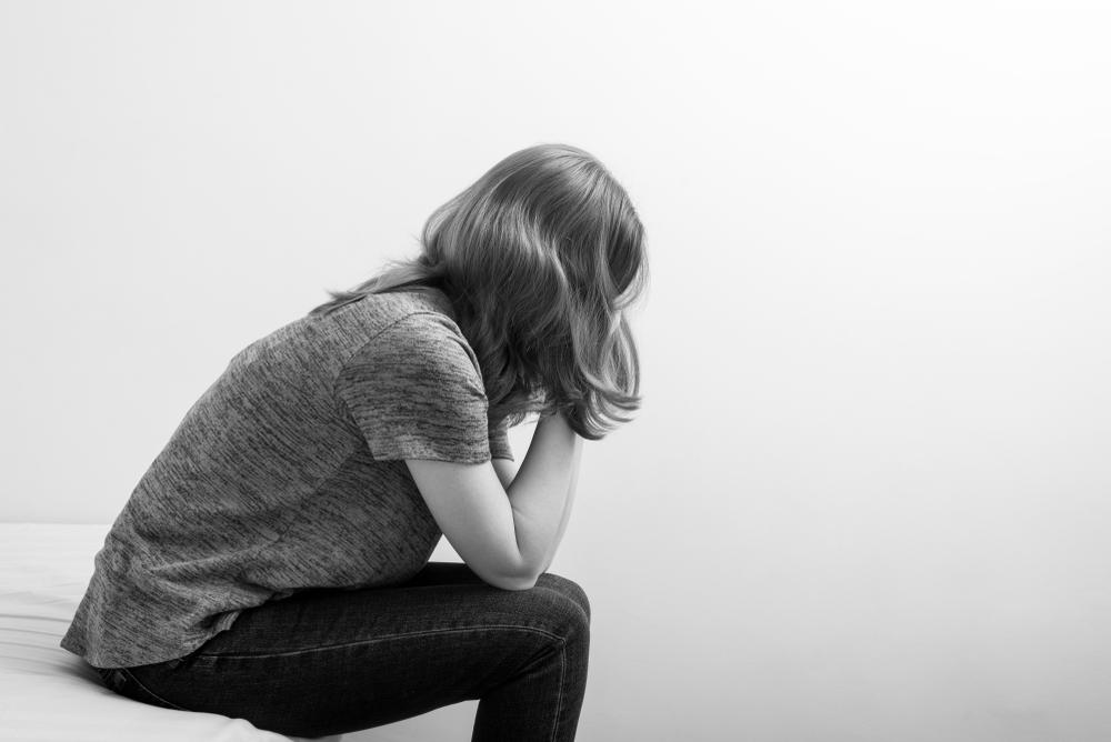 Sad woman sitting www.herviewfromhome.com