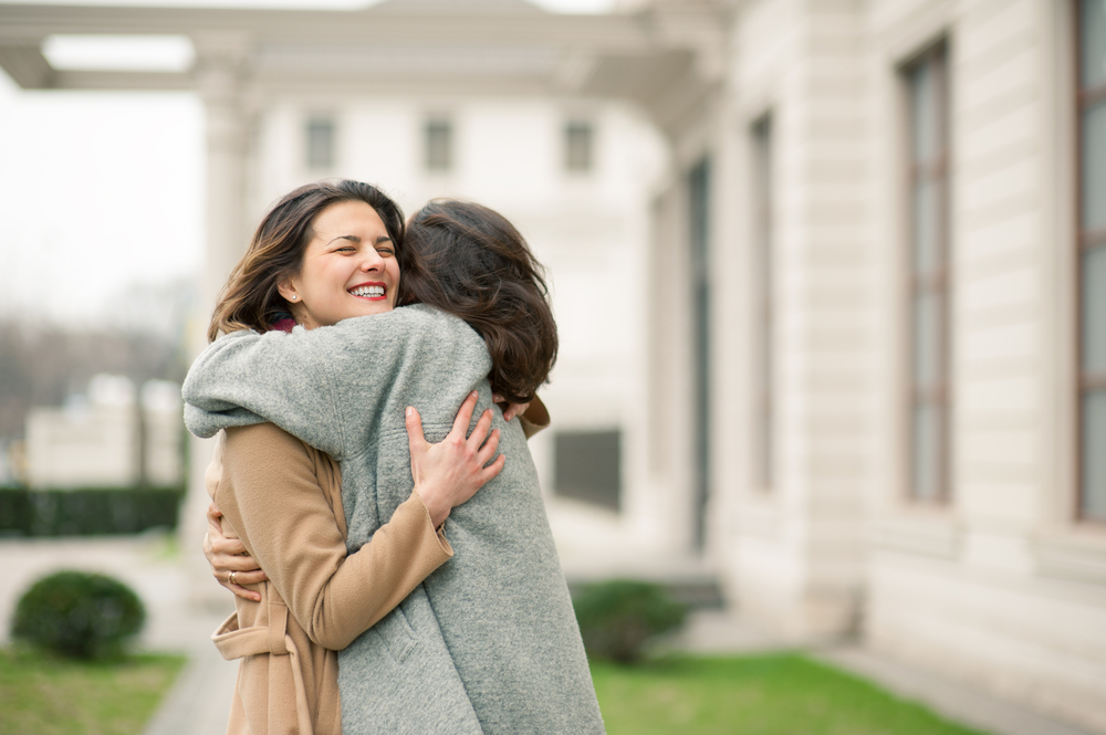 women hug www.herviewfromhome.com