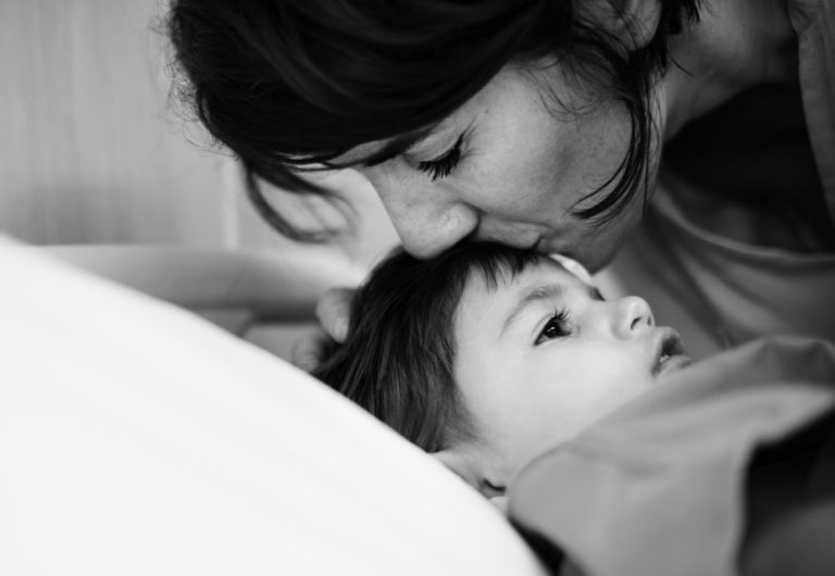 mother kisses child www.herviewfromhome.com
