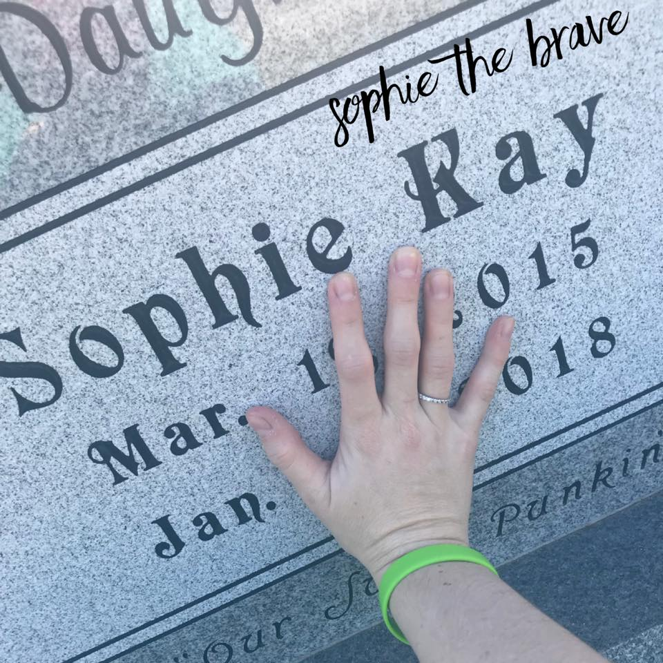 Mother's hand on Sophie Kay gravestone