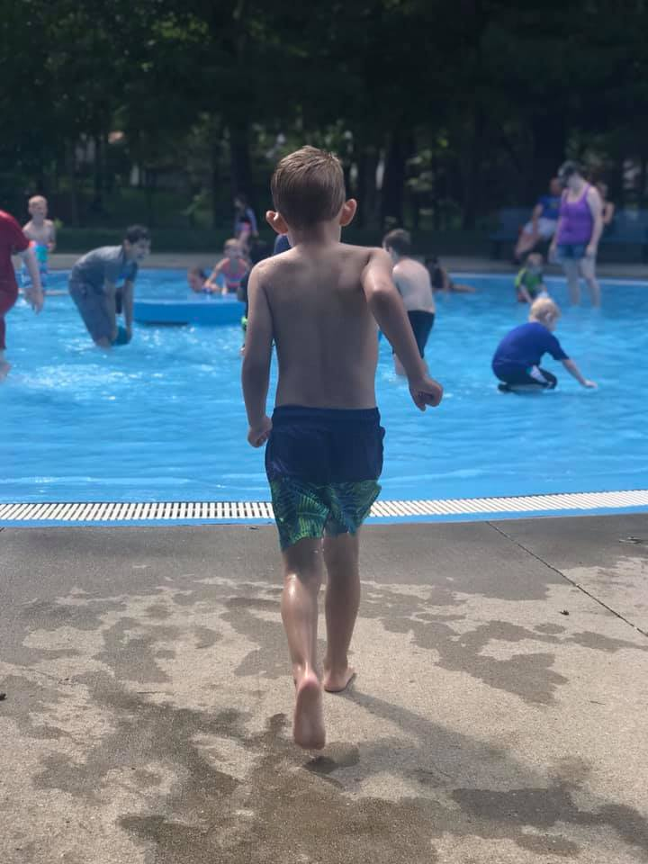 Boy about to jump into swimming pool