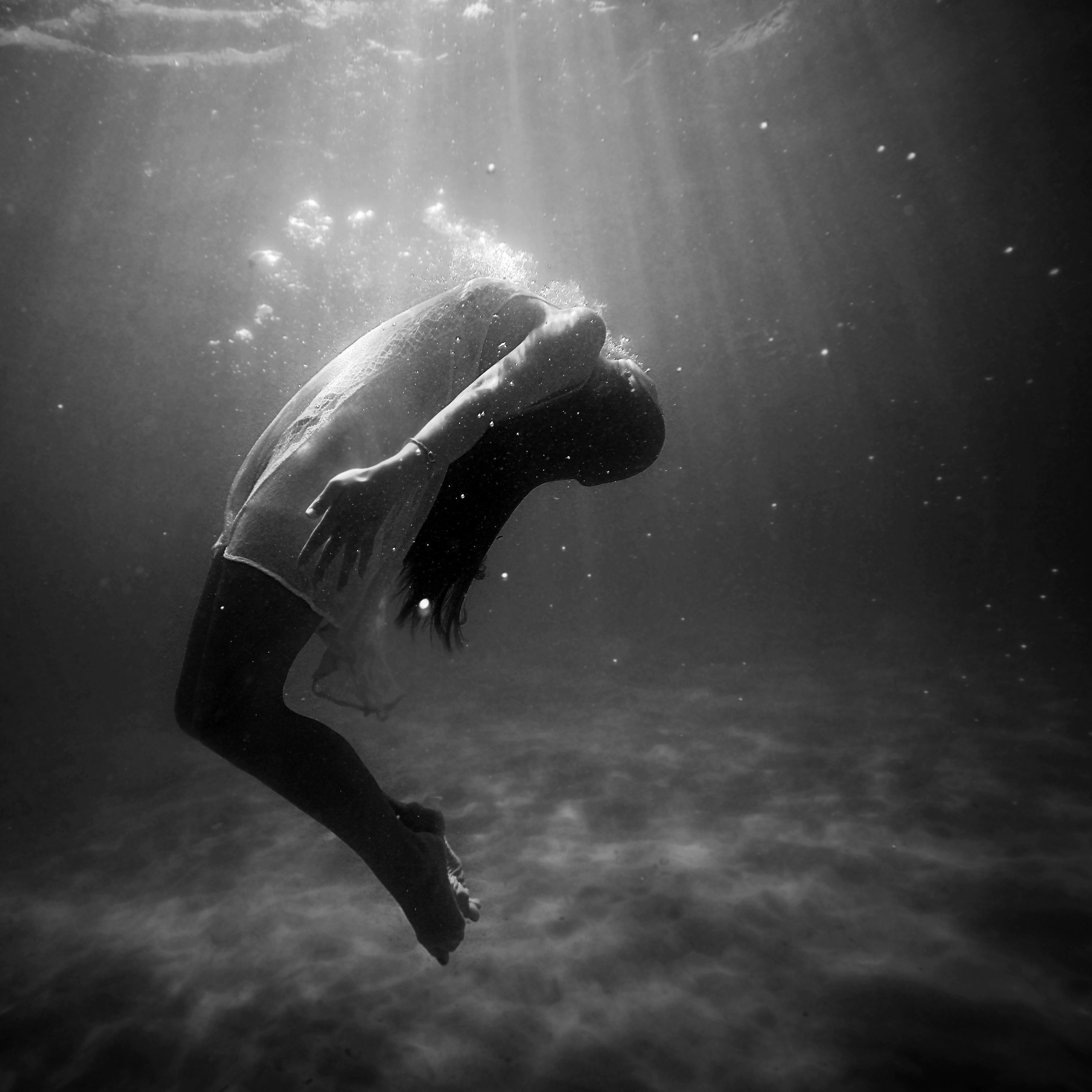 Black and white profile image of woman underwater