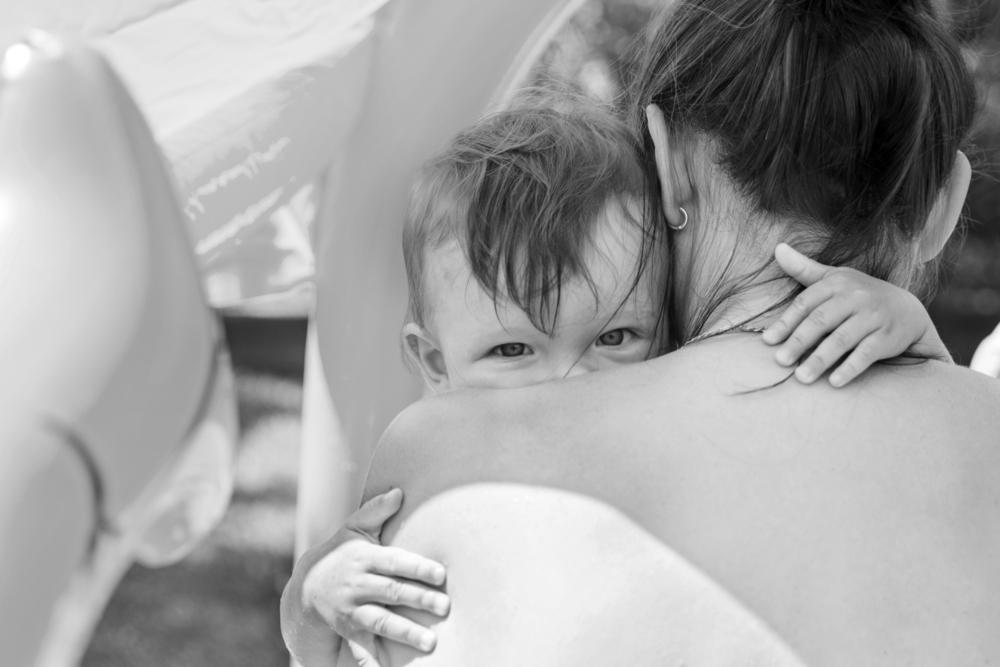 Little boy hugs his mother