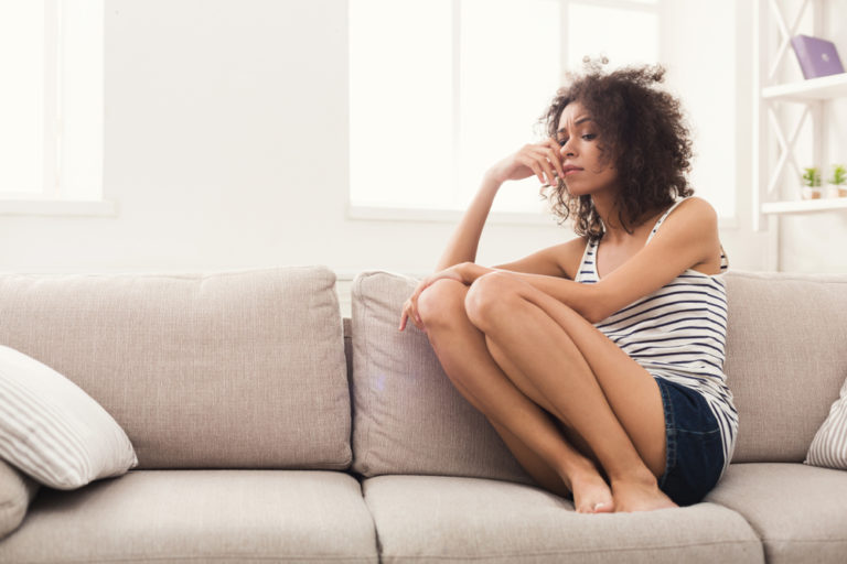 Grieving mother on the couch at home
