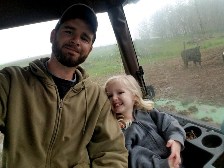 Farmer and daughter in tractor