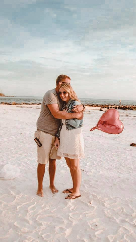 Man hugging woman on the beach in nostalgic photo