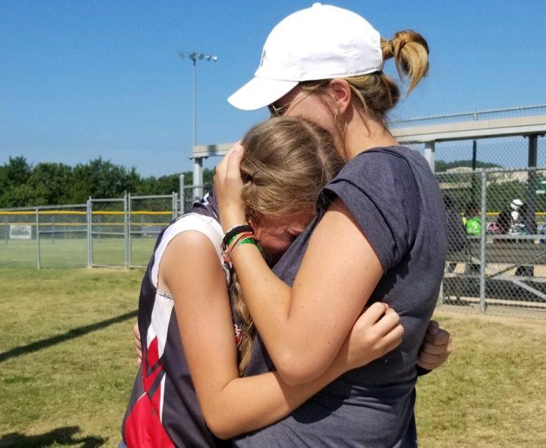 Mother hugs teen daughter