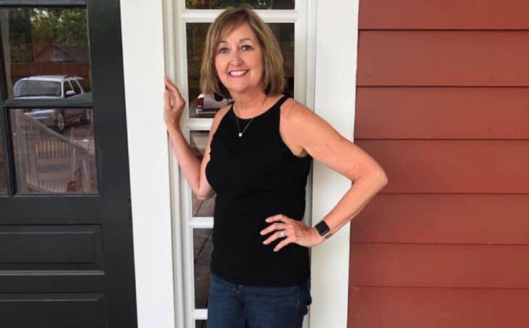 Jenn Kish single mother stands in doorway smiling