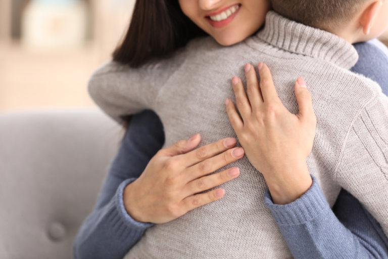 Mom hugging foster son