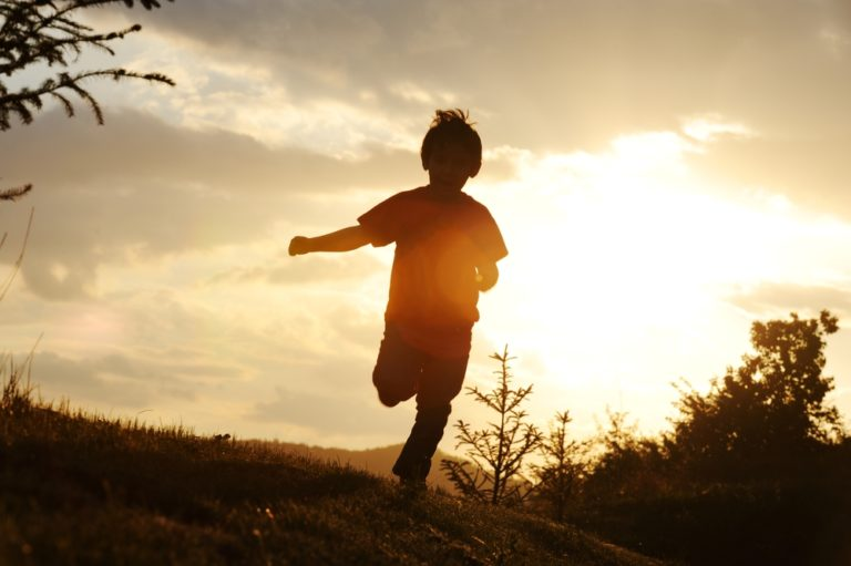 child running in the sunset