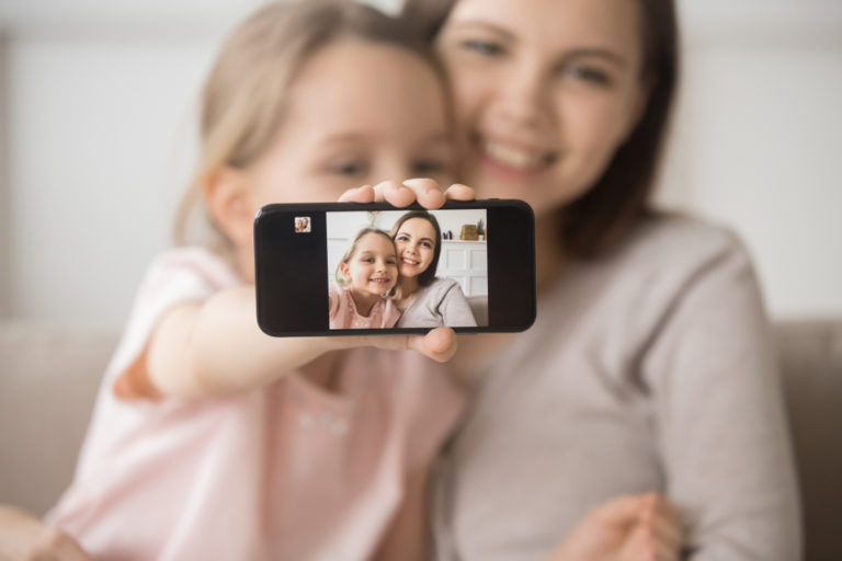 Mother and daughter taking a picture together