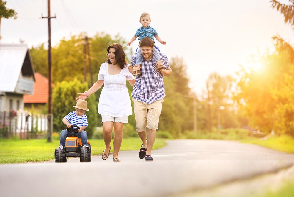 Family walks down rural street