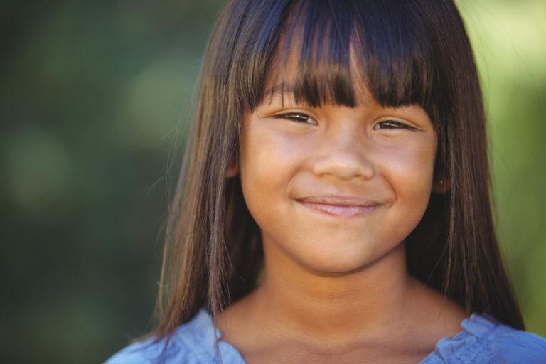 Close up of a young girl smiling at camera