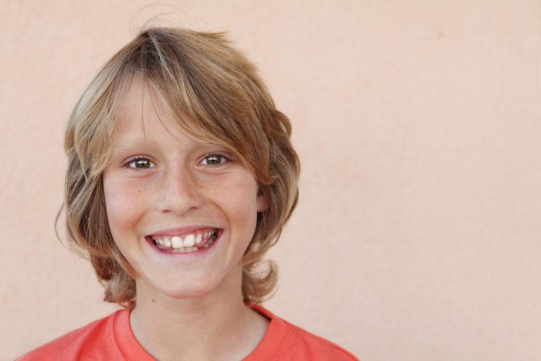 13 year old boy smiling at camera