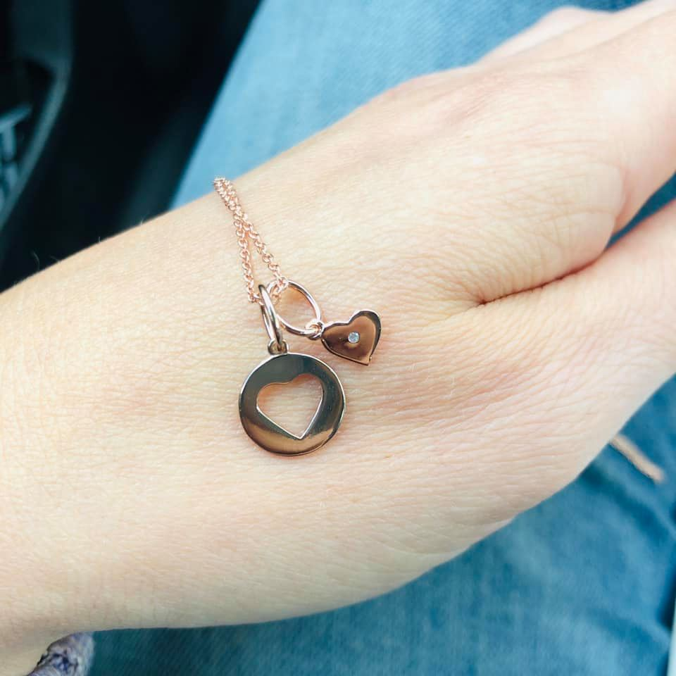 Heart necklace on a hand