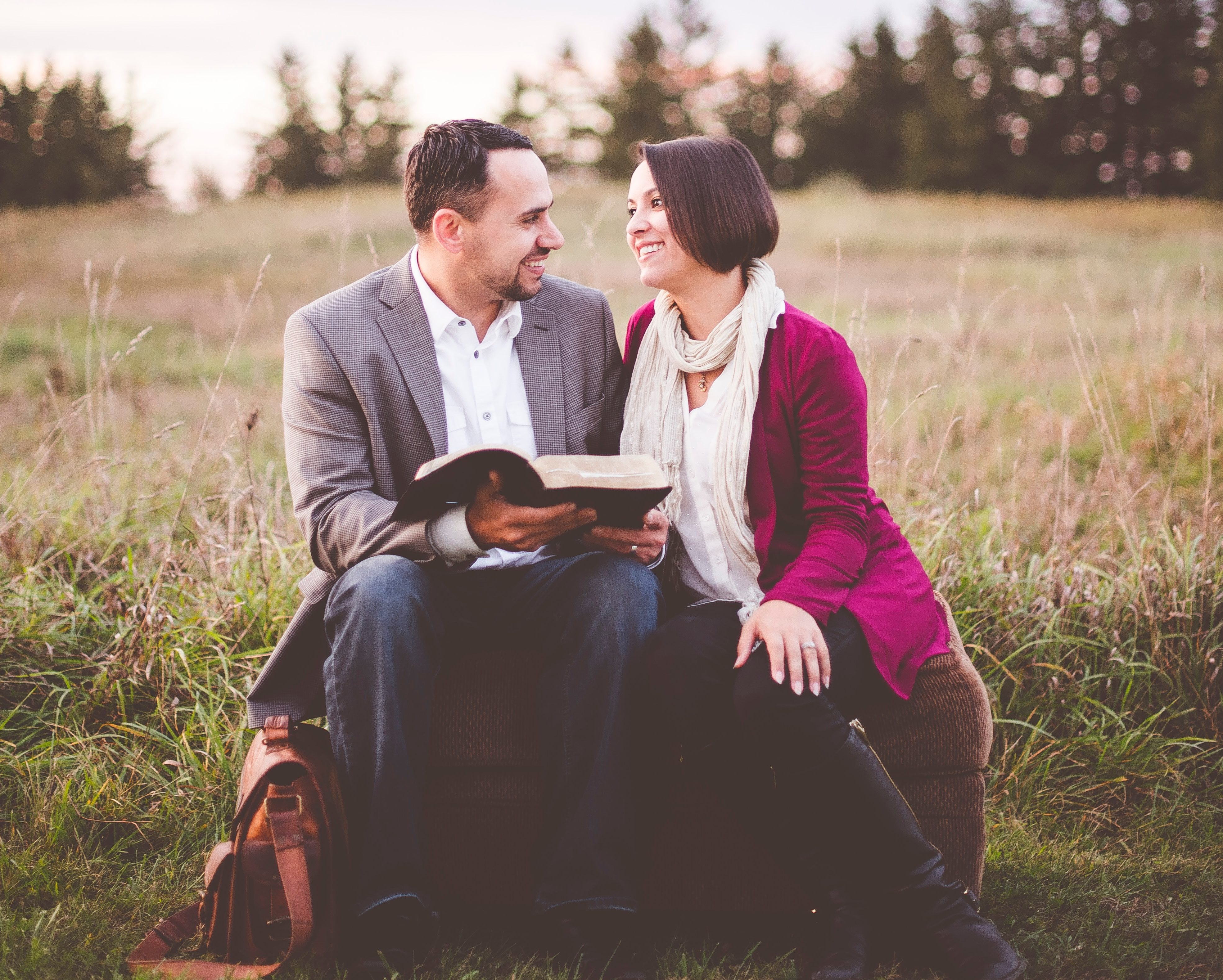 Pastor and wife sit outside and look at each other