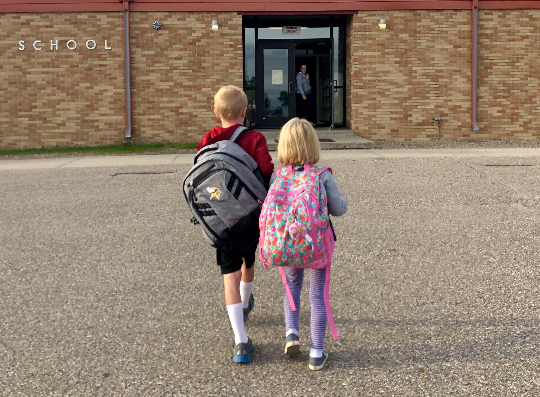 Kids walking into school