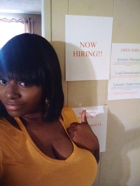 "Mom stands in front of ""Now hiring"" sign at home for kids"
