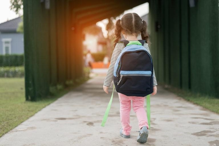 5 year old kindergarten girl walking to school