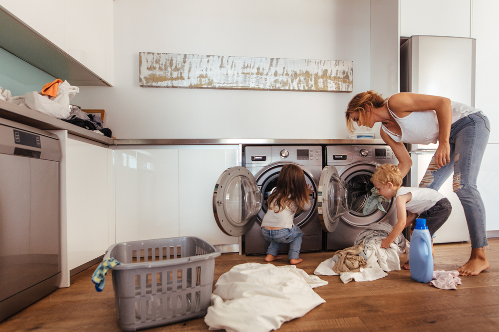 Mother and children doing laundry at home