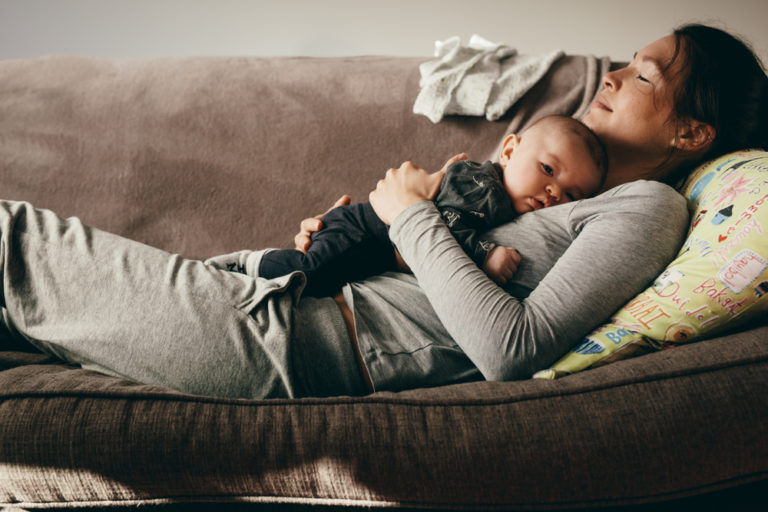 Mother and child relaxing on the couch