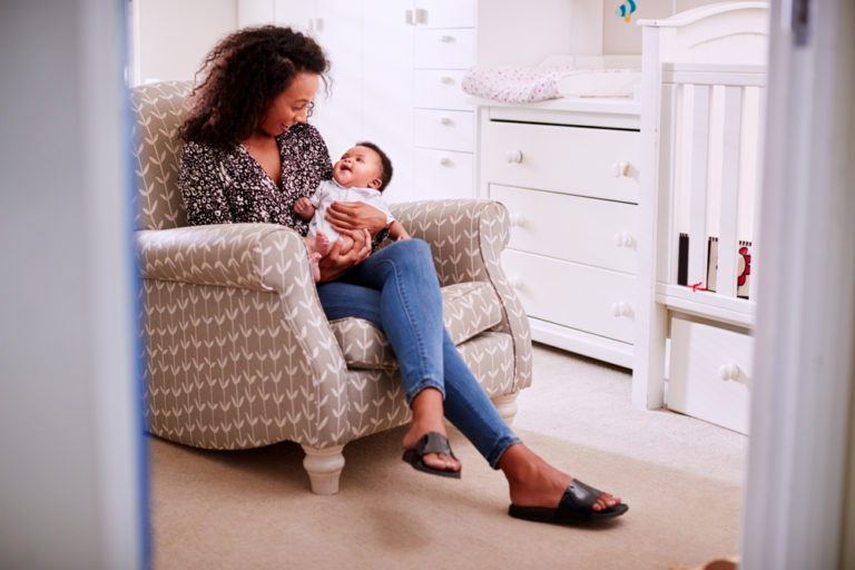 Mother and child in rocking chair at home